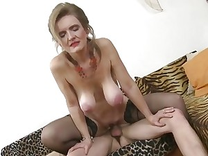 Trendy blonde mom in stockings enjoys being drilled by lad