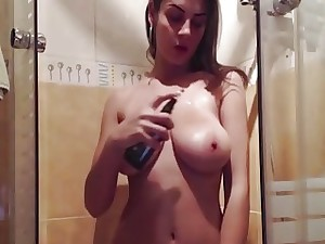 Brunette amateur with amazing all-natural melons masturbates in the shower