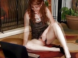 Nikki Rhodes plays with her furry vag