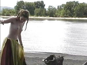 Hippie in Micro-skirt Dancing by River